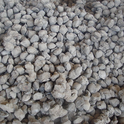 High iron and high calcium synthetic sand